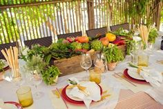 A farm fresh colorful and inviting centerpiece for this table setting