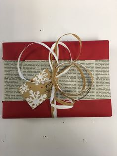 Find out how to wrap gifts with newspaper so they actually look cute! 4 ways.
