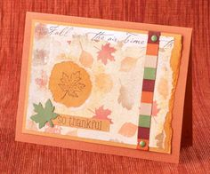 A striped accent ribbon placed atop a simple patterned paper helps bring the colors of the season to life. SOURCES Paper: Bazzill Basics Paper (Yam), Stampin' Up! (More Mustard, Old Olive), Karen Foster Design (Harvest Leaves). Stamps: Hero Arts (Happy Thanksgiving). Ink: Stewart Superior Palette (Burnt Umber). Ribbon: American Crafts (Seasons Elements). Accents: Bazzill Basics Paper (green brads). Leaf Punch: Creative Memories./