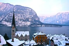 Hallstatt, Austria This little hidden gem is the perfect winter escape you've been looking for. Snow? Check. Charm? Check. Dark cozy nights by the fire? Check.