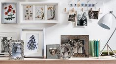 Assorted picture frames on a wall | Stylish and tidy living room hacks | Tesco Living