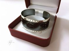 Bangle with Latvian traditional symbols by Paula Treimane Material: silver 925 / partly oxidized / commission piece