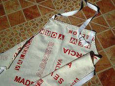 Items similar to SOLD.Plain & Practical Spanish Cities Chefs apron with buckle neckband. on Etsy Chef Apron, Apron Designs, Aprons, Chefs, Paper Shopping Bag, Cities, Spanish, Trending Outfits, Unique Jewelry