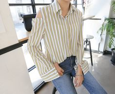 Stylize your killer shoulder blades with this cutout stripe shirt from Daily About.