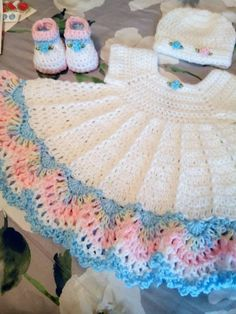 White crochet baby dress set with multi color trim comes with