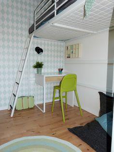Loftbed, ikea desk and harlequin wallpaper