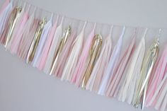 2m handmade tassel garland featuring 25 tassels made from high quality tissue paper and mylar.  If you are ordering this garland for an event on a