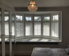 Full height basswood shutters with a louvre fitted to a bow bay window with a seat – rugcut Bay Window Bedroom, Bay Window Living Room, Bedroom Shutters, Bay Window Curtains, Interior Window Shutters, Bay Window Seats, Interior Design Degree, Best Interior Design Websites, Bow Window Treatments