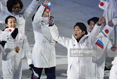 SOCHI Russia Japanese figure skaters Mao Asada Daisuke Takahashi and Tatsuki Machida march during the closing ceremony for the Winter Olympics at...