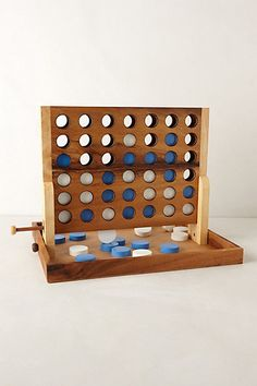 Captain's Mistress Strategy Game - anthropologie.com Just bought this for the game room! Classy Connect Four.
