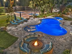 With a fire pit, the backyard is perfect for entertaining at night.  Source: The Agency