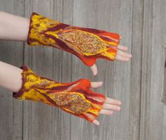 Hand felted mittens in orange, yellow and maroon, with wool curls and pieces of silk fabric . Beautiful Gifts, Beautiful Things, Winter Accessories, Orange Yellow, Silk Fabric, Colorful Fashion, Arm Warmers, Wool Felt, Mittens