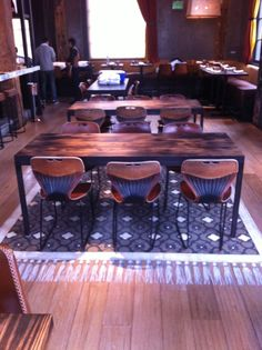 Coqueta stenciled painted floor rug on wood flooring. Michael Chiarello's restaurant, San Francisco. Caroline Lizarraga used the Chez Ali Moroccan Stencil Pattern - Catherine Nguyen Photography