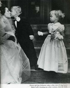 """Flower girl Jan Schlueter takes a dim view of ring bearer Ricky Lofy's bussing any other woman, even the bride."" New York, 1949"