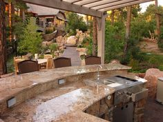 A pergola over an outdoor kitchen can give the feeling of an outdoor room without taking away from the view or sunlight. A pergola can also bring some shade to the space without giving it complete cover. Small Outdoor Kitchens, Outdoor Kitchen Bars, Backyard Kitchen, Outdoor Kitchen Design, Patio Design, Outdoor Rooms, Outdoor Dining, House Design, Outdoor Decor