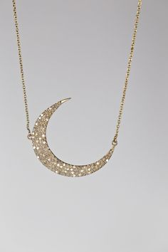 A personal favorite from my Etsy shop https://www.etsy.com/listing/293513335/matte-gold-pave-diamond-crescent-moon
