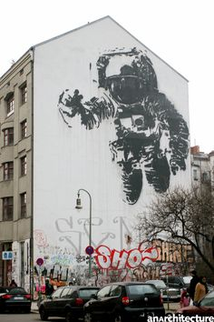 "The Kosmonaut in Berlin, Kreuzberg is the work of the French graffiti artist Victor Ash.    ""There is something lonely and helpless about this Kreutzberg astronaut; attached to nothing, without purpose and without context. He looks like he is about to float off the wall and into space - the eternal unknown that humans have not yet managed to conquer after all."" (Miriam Nielsen)"