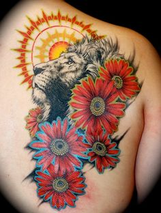 Lion tattoo. idky but I really like this....maybe its the trippy colors....