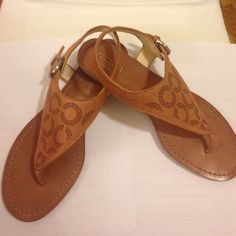 Coach Oliana Leather Sandals Tan coach Oliana leather sandals. Great condition. Right heel area has minor discoloration as pictured. Coach Shoes Sandals