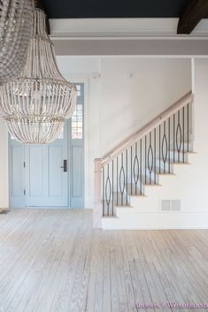 Our AMAZING new iron stair railings!... Sharing details on our beautiful new staircase balusters and a full updated foyer tour on the blog! foyer-white-walls-blue-front-foor-uncertain-grey-stardew-alabaster-sherwin-williams-iron-baluster-staircase-whit