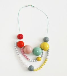 Some of my favorite colors was found in this wood necklace by Kristina Klarin
