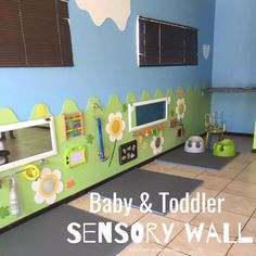 Sensory Wall for Baby & Toddler - Teach Me Mommy - Sensory Wall for Baby & Toddler – Teach Me Mommy A fantastic sensory and activity wall for babies & toddlers! Toddler Daycare Rooms, Infant Toddler Classroom, Daycare Spaces, Childcare Rooms, Preschool Rooms, Daycare Nursery, Infant Daycare Ideas, Kids Daycare, Kid Spaces