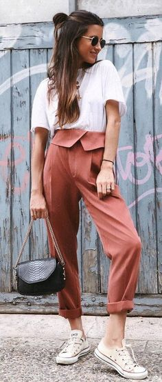 casual outfit inspiration white tee   bag   brown pants   sneakers