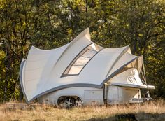 enthoven design associates\' \'opera\' camper takes a traditional two-person trailer and combines it with most household amenities in the form of the sydney opera house.