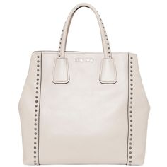 Sport chic style carrying this Miu Miu leather tote accented with polished studs on the handles and bag. Equipped with a bonus shoulder strap, the top-handled tote expands to offer extra room for your gear.