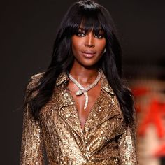 Naomi Campbell wearing a diamond-encrusted Bulgari Serpenti necklace on the fashion catwalk. Discover more of Bvlgari's iconic and famous designer jewellery: http://www.thejewelleryeditor.com/jewellery/bulgari-history-of-style-celebrities-iconic-design/ #jewelry