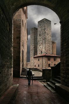 "San Gimignano is a small walled medieval hill town in the province of Siena Tuscany, Italy. Known as the Town of Fine Towers, it is famous for its medieval architecture which, with its hilltop setting & encircling walls form ""an unforgettable skyline""."