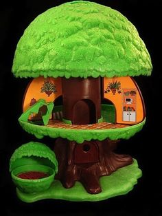 This little house was perfectly designed to capture your imagination. It was a tree that with the push of a button (on the top of the tree) revealed a three-room house, that came complete with an elevator, staircase, swing, and garage.
