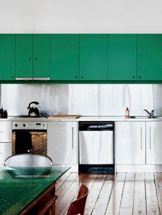 stainless steel backsplash, green cabinets.