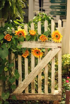Garden gate - I know the sunflowers are fake but they still look pretty!