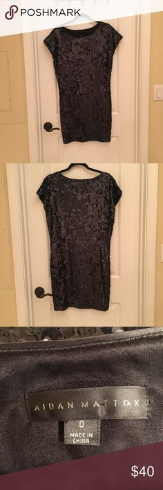 """Aidan Mattox Black Sequin Shift Dress, size 0 Aidan Mattox Black Sequin Shift dress, size 0. All-over sequins. Sequins are in good condition. No obvious flaws or areas of missing sequins. Cap sleeves. Boxy fit. Approx 36"""" in length and measures approx 17"""" from armpit to armpit. Aidan Mattox Dresses"""