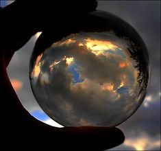 stormy clouds in the ball (april-mo) Tags: glass clouds circle photography experiments sphere kugel glasswork crystalball stormyclouds dasman spheric cristalclear bouledecristal shiningballs spiegellungen nonopticalglass