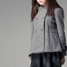 Wool short overcoat A short take on the classic overcoat. Made from wool and polyester. Contains 53.9% wool, 32% polyester and 14.1% viscose fiber. The slightly open hem makes this short overcoat a fashionable and special coat. Come to take it.  Jackets & Coats