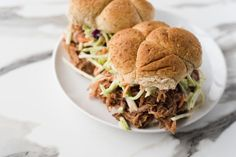 Paula Deen's Favorite Pulled Pork Sandwich will put all other pulled pork recipes to shame. This is one of the more flavorful pulled pork recipes on the planet and that's because it was created in the South. Besides the main ingredient, your pork marinates in a sauce that is simply unbeatable. It's made up of brown sugar, paprika, Sprite, apple cider vinegar, BBQ sauce and a few other ingredients just to give you a sense of the unique flavor you'll achieve. This is a great sum...
