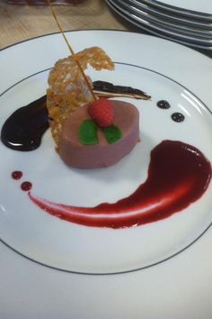Dark chocolate pomegranate Bavarian cream with almond lace cookie and sugar garnish