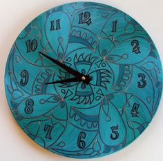 Wicked Clock in Turquoise - Tribal Geometry - Psychedelic Mandala Hand Painted on Recycled Vinyl Record. $55.00, via Etsy.