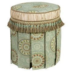 Ottoman with medallion upholstery and cord and tassel fringe.   Product: OttomanConstruction Material: Polyester ...