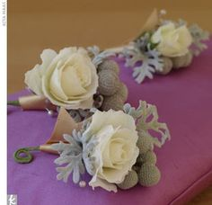 The groom will wear a pinned boutonniere featuring ivory spray roses and silver brunia tied with ivory ribbon with the stems showing.   @Christina Childress Childress Childress Sanders  Corsages and boutonnieres   White roses, dusty miller, and silver brunia