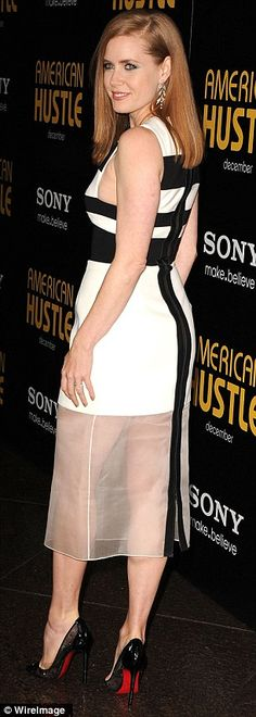 Amy Adams showed off her legs in a fitted black-and-white dress with see-through white panels. Gorgeous!