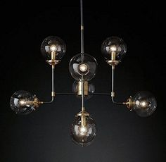 Inspired by 1940s industrialism, our globe chandelier's lines and spheres are reminiscent of an urban subway map. Eight glass shades are joined by metal tubing and carefully balanced on vertical threaded rods.   eBay!