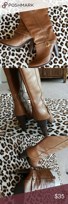 Leather Ralph Lauren boots 8 In very good condition 4 inch heels, leather in a dk camel color. Just purchased off Posh but to high for my comfort.  My loss is yr gain. Ralph Lauren Shoes Heeled Boots