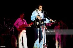 1975: Photo of James BURTON and Elvis PRESLEY, with James Burton on guitar - performing live onstage