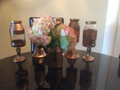 Iamrosamaria 🌹🌹🌹DIY mason candy/flower jars ..............……..........................................       - reused spaghetti/strawberry jam jars  -glass candle sticks from the 99 cents store -rose gold spray paint from michaels  -E6000 glue from Michaels