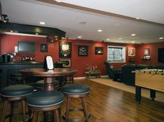 If you want the ultimate basement hangout, design a floor plan that accommodates informal dining, lounging and playing games.