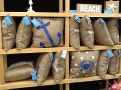 Burlap and beach themed pillows from Beach Cottage Designs.  A staple for Cape Cod decorating.