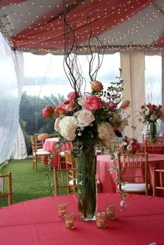 Rich Coral Wedding Inspiration   Weddingomania Don't like the sticks w/ the floral arrangement but love how they did the ceiling of the tent. What do u think?